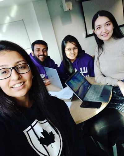 Aditi Verma with three fellow students doing some group work