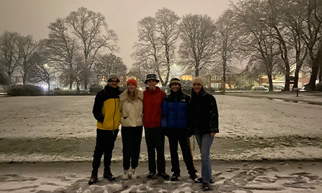 Amy Wells and her friends in a park in the snow