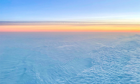 A view of a sunset from an airplane window