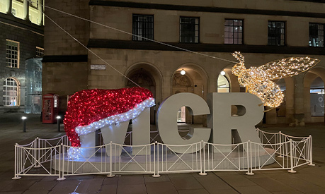 The MCR sign outside Central Library in Manchester with a santa hat on the letter M