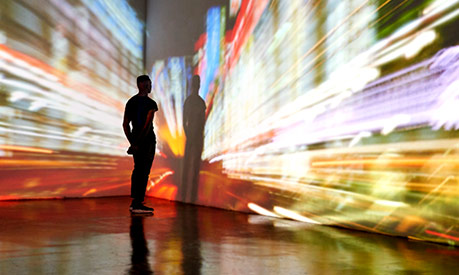 man looking at large screen with bright colours