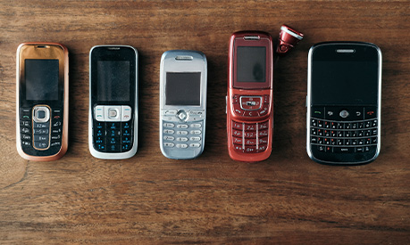 a collection of old mobile phones