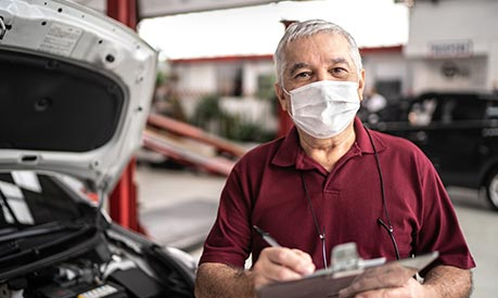 senior auto repair man wearing mask