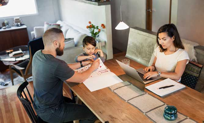 Couple working at home with a child