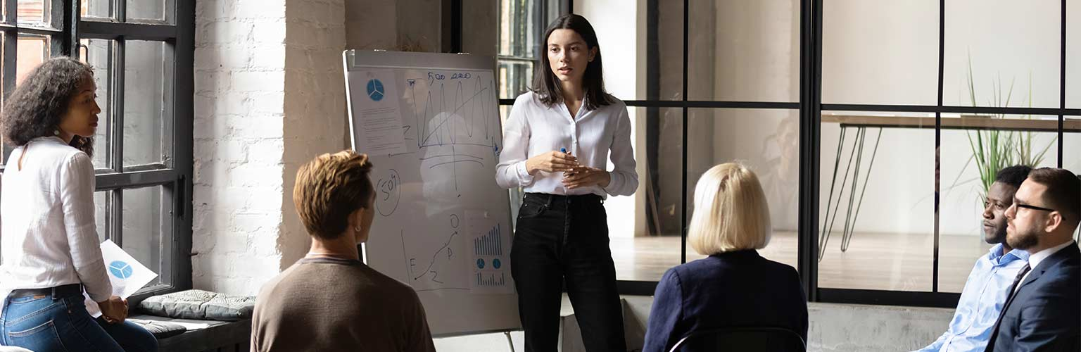 confident lady business trainer coach give flip chart presentation