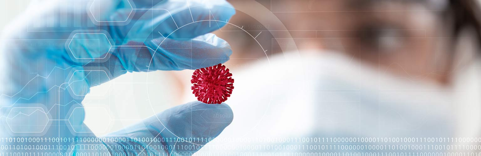 Lab technician holding image of virus