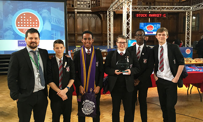 students celebrating success at the annual stock market challenge