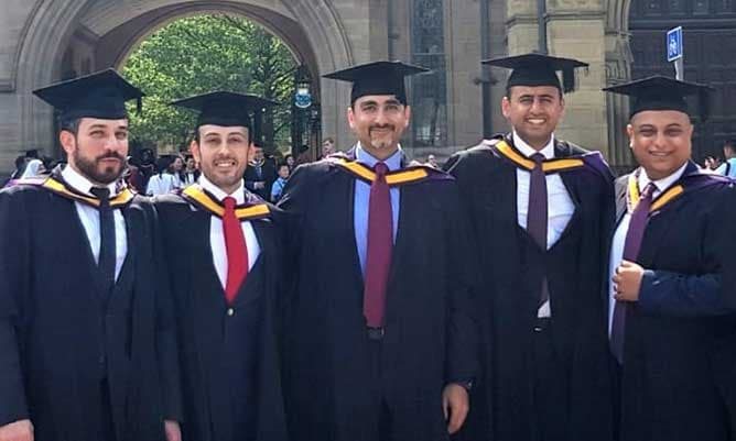 Group of male MBA graduates