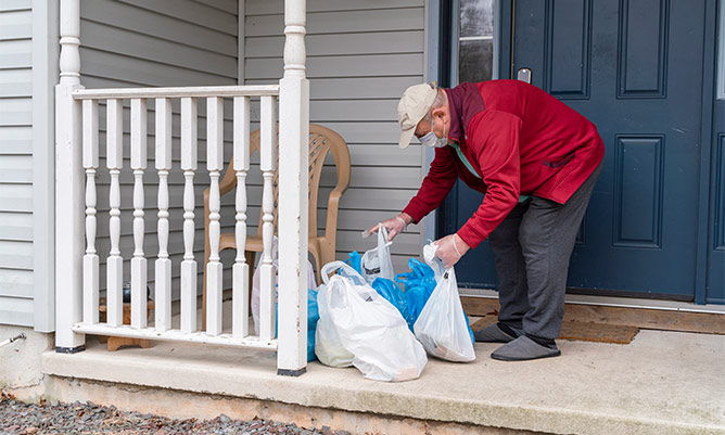A vulnerable man getting his shopping left on his porch