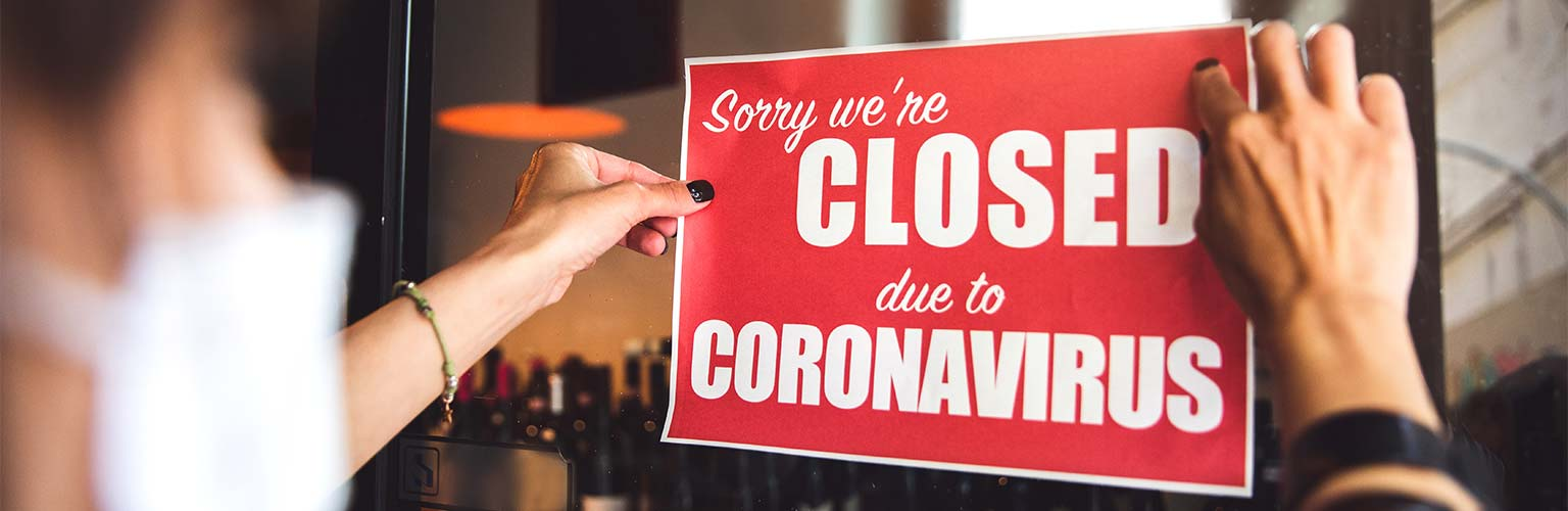 A sign in a shop saying they are closed due to coronavirus