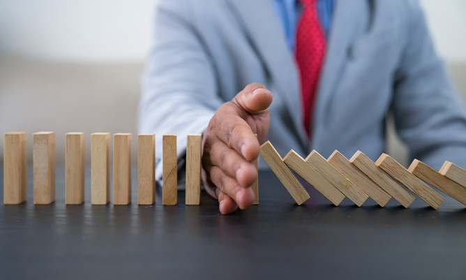 Stopping the domino effect with a hand
