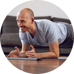 a man exercising at home in a yoga pose