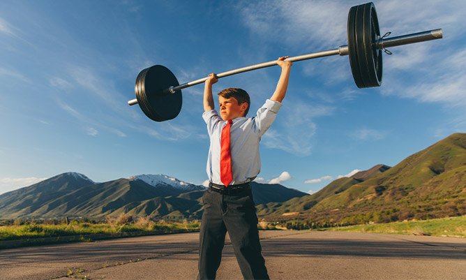 A young businessman lifting weights