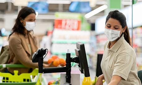 supermarket checkout woman wearing face mask