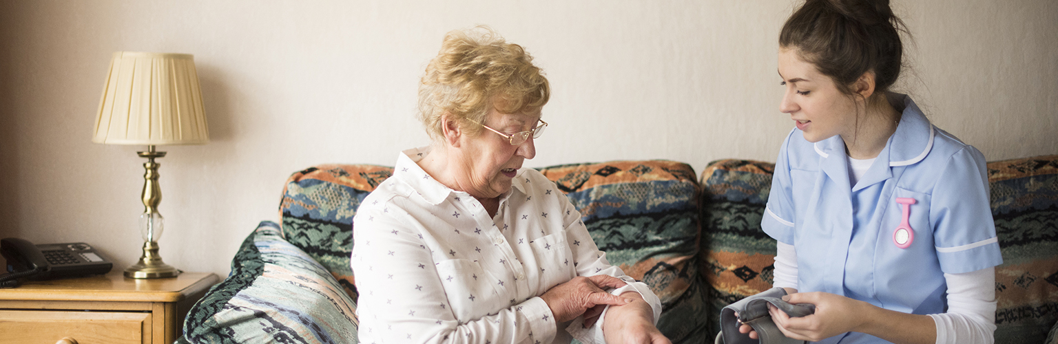 nurse in home with patient health social care